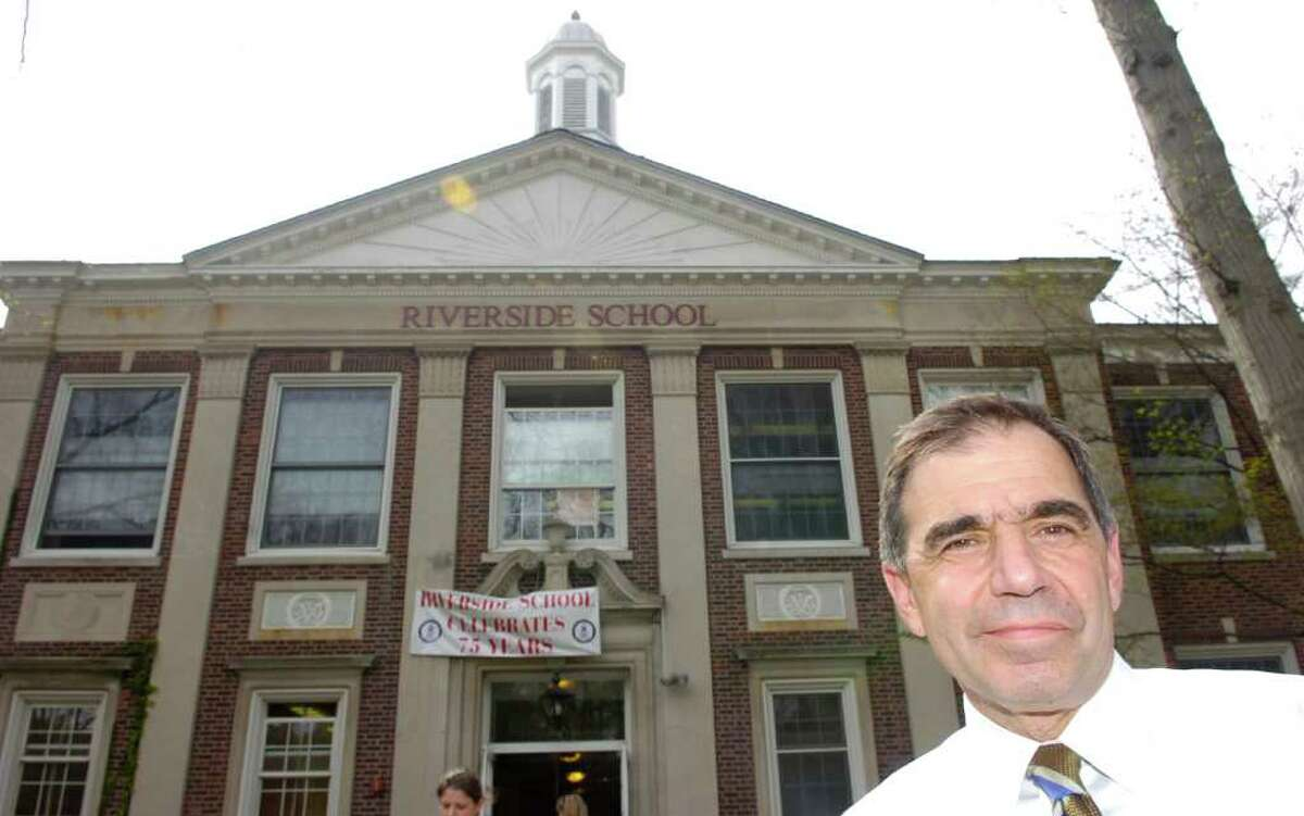 In this April 2008 file photo, Riverside School Principal John Grasso in front of the school, which was celebrating its 75th Anniversary.