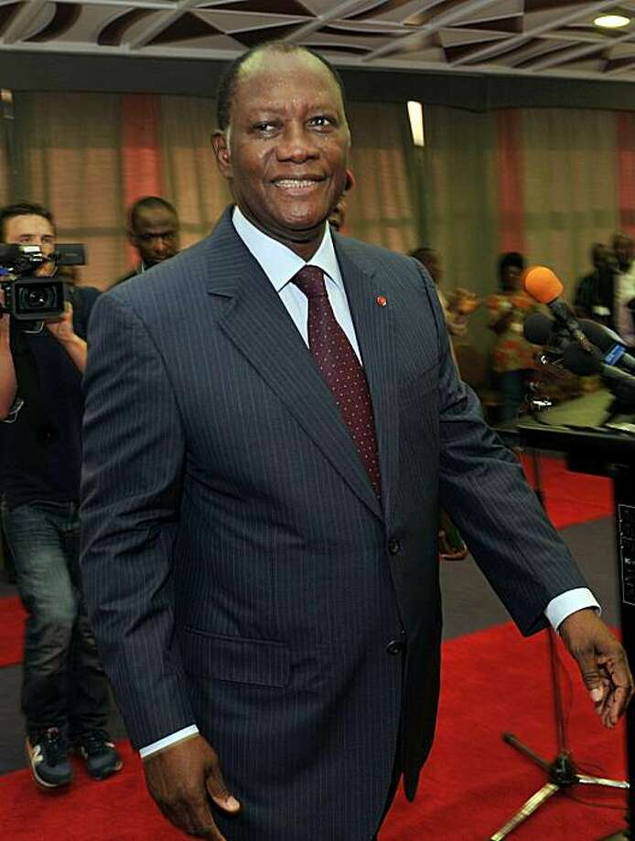 """Ivory Coast's internationally recognised leader Alassane Ouattara smiles after giving a press conference on December 24, 2010 at the Golf hotel in Abidjan. Ouattara urged the army to desert his rival Laurent Gbagbo and to protect civilians against attacksby """"foreign mercen. Photo: Issouf Sanogo, AFP/Getty Images"""