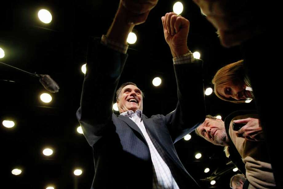 """Mitt Romney, campaigns Friday in Aiken, S.C. The GOP hopeful often points to a steel mill of Bain Capital that employs 6,000. What he fails to mention, critics say, is the """"corporate welfare"""" that helped the start-up. Photo: Charles Dharapak / AP"""