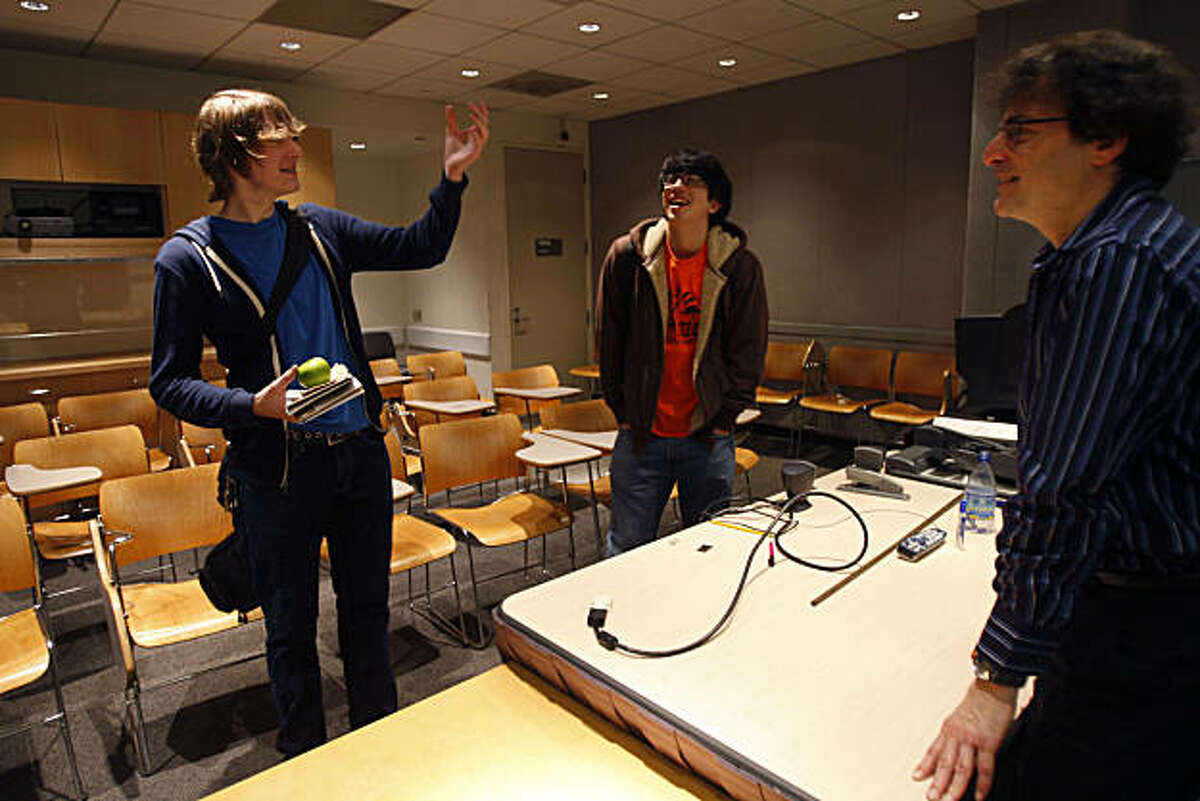 Kevin Foote (left) talks about photography with fellow classmate Nicholas Chang (center) and professor Brian Barsky (right) after class in Berkeley, Calif., on Dec. 03, 2010. Brian Barsky, a UC Berkeley professor, teaches a freshman class on photography and activism in Berkeley, Calif., on Dec. 03, 2010.