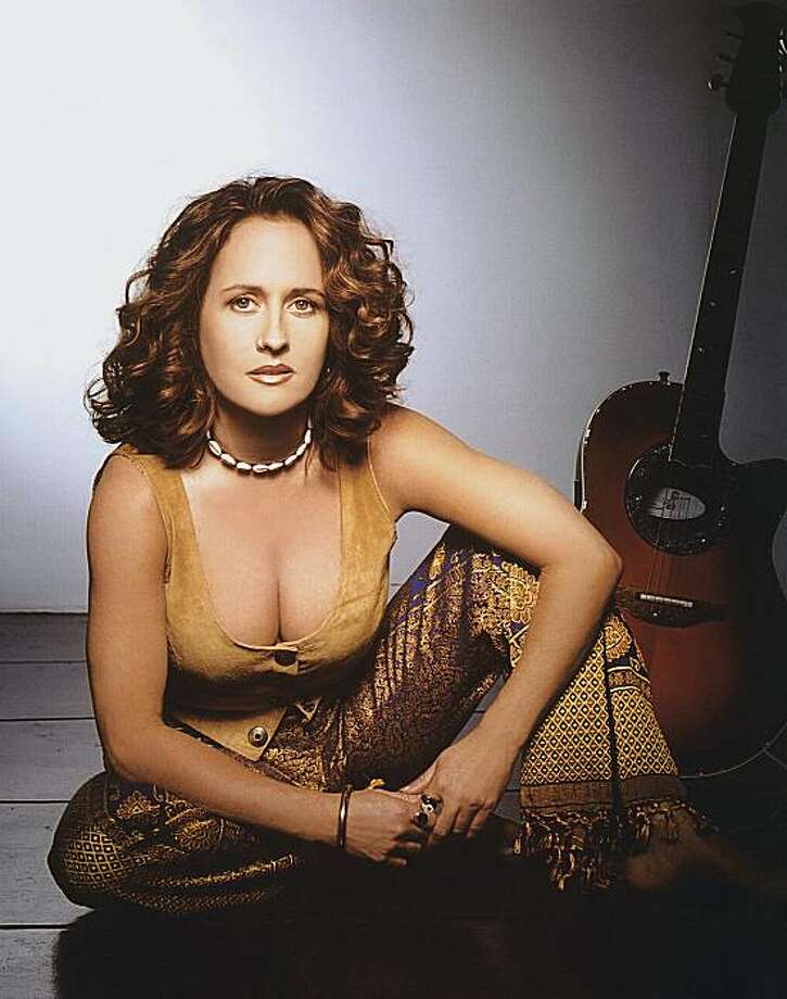 "In this 2005 file image originally released by Universal Music, musician Teena Marie is shown. Marie, who made history as Motown's first white act but developed a lasting legacy with her silky soul pipes and with hits like ""Lovergirl,"" ""Square Biz,"" and ""Fire and Desire"" with mentor Rick James, has died. She was 54. Photo: Tracy Jones, AP"