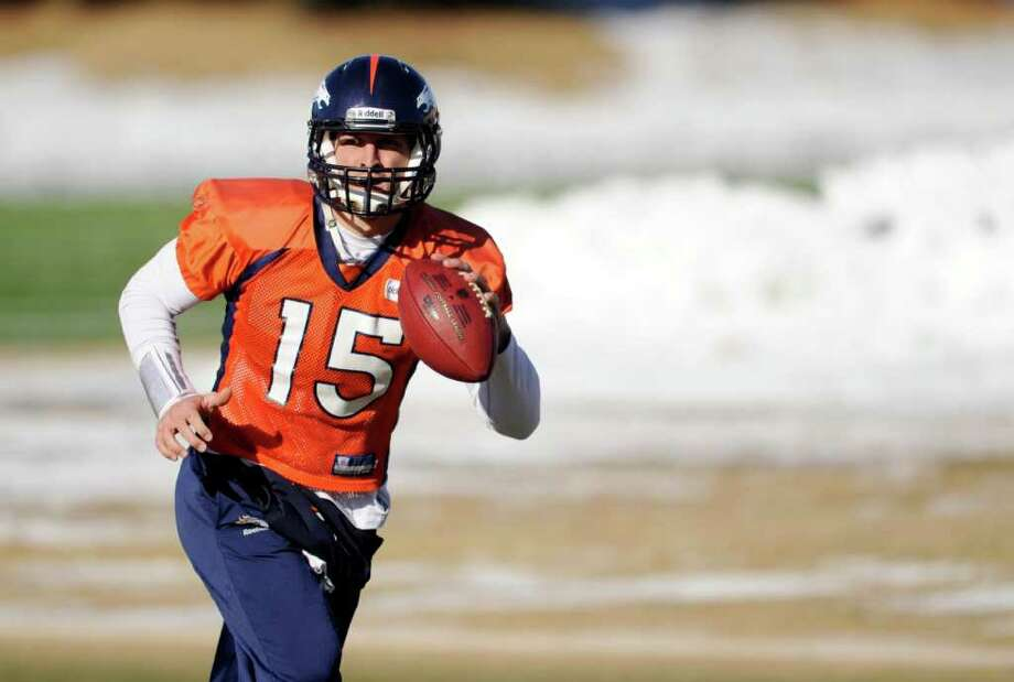 Broncos quarterback Tim Tebow practices Thursday. The Foxborough forecast call for temperatures in the single digits. Photo: AP