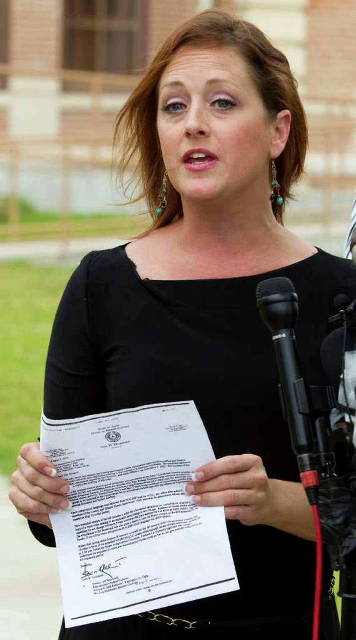 Nikki Araguz, the transgender widow of Wharton firefighter Thomas Araguz, killed in the line of duty in 2010, talks outside the Wharton County Courthouse during a break in the hearing to decide the fate of the firefighter's death benefits Friday, May 20, 2011, in Houston. A motion before the court by Heather Delgado,Thomas Araguz' ex-wife and mother of his two children, claims the marriage between Thomas and Nikki wasn't legal because Nikki was a man at the time. ( Brett Coomer / Houston Chronicle )
