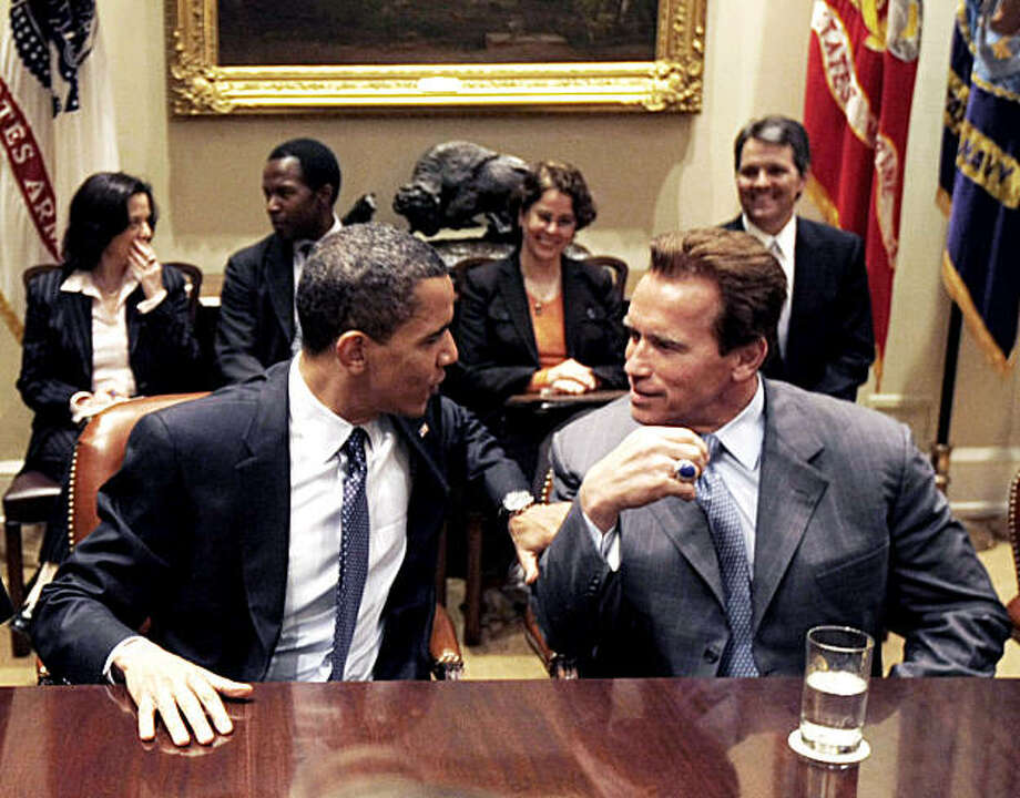 President Barack Obama talks to California Governor Arnold Schwarzenegger, after making remarks in the  Roosevelt Room of the White House in Washington, Friday, March 20, 2009. (AP Photo/Gerald Herbert) Photo: Gerald Herbert, AP