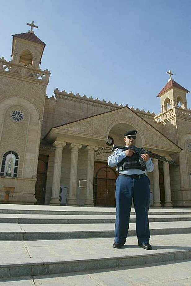 An Iraqi policeman stands guard outside a church in the ethnically mixed northern Iraqi city of Kirkuk on December 21, 2010 as part of security measures to protect Christians, after 44 worshippers were killed in a late October attack on a Baghdad church. Photo: Marwan Ibrahim, AFP/Getty Images