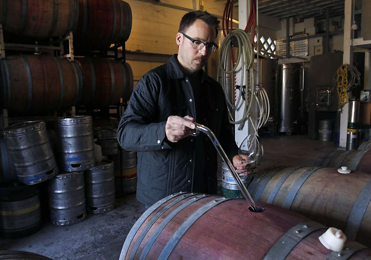 Winemaker Chris Brockway pulls a sample of his 2011 Arrowhead Mountain zinfandel at his Broc Cellars winery in Berkeley, Calif. on Thursday, Dec. 15, 2011.