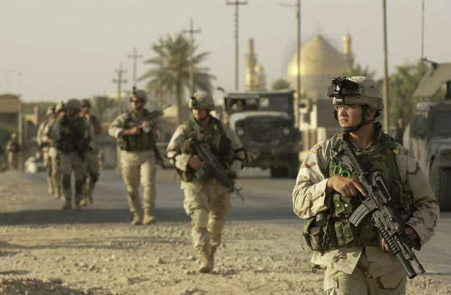 New York Army National Guard Soldiers assigned to New York Army National Guard?s 2nd Battalion, 108th Infantry patrol in Samarra in Iraq in 2004.