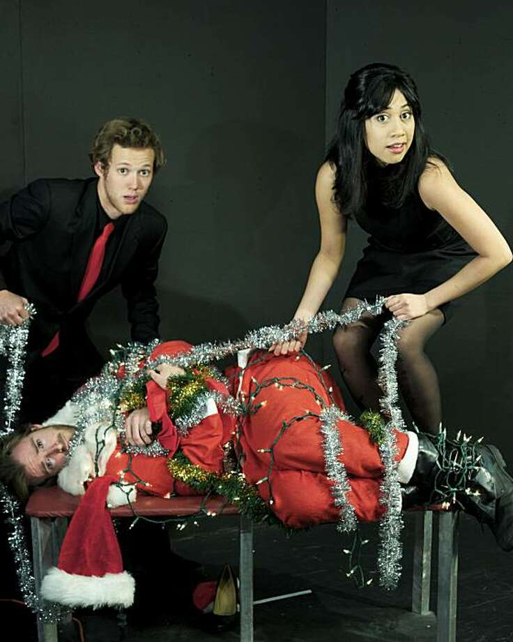 """Hosts Jed Goldstein (left) and Gabrielle Patacsil deal with an incapacitated mall Santa (Derek Fisher) in PianoFight's """"Forking II: A Merry Forking! Christmas"""" Photo: Chrisannethemum Jones"""