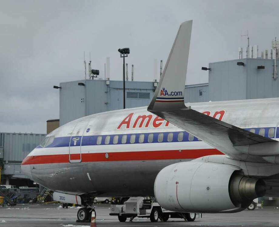 The American Airlines 737 sits on the apron of the Albany International Airport in Colonie, N.Y. Jan. 13, 2012 and will be leaving this evening at 5:00pm.   ( Skip Dickstein/Times Union) Photo: Skip Dickstein / 2011