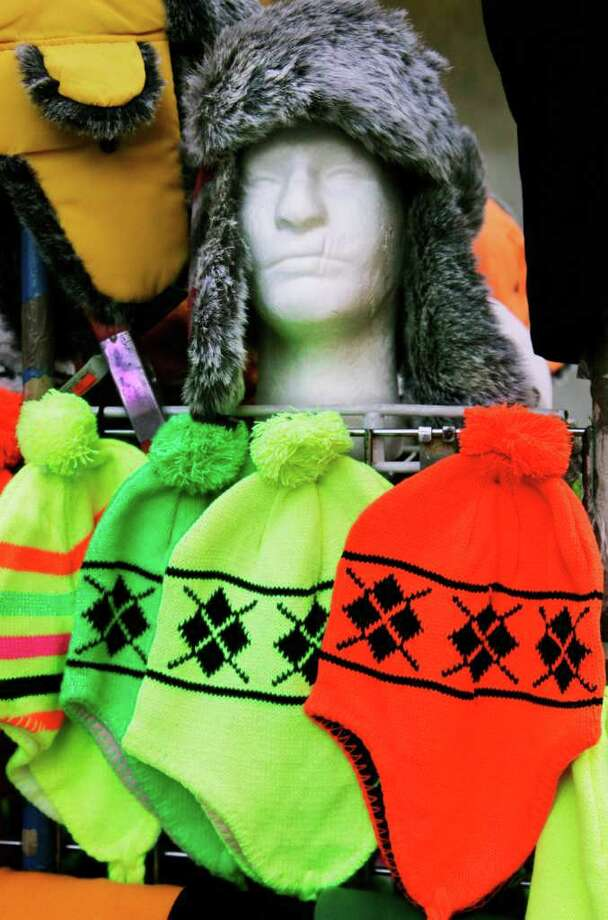 FILE - In this Jan. 11, 2012 photo, winter hats are displayed on a sales rack, in New York. Stores are supposed to be in the throes of clearing out cold weather items like coats and wooly sweaters to make room for spring receipts. Instead, unusually mild temperatures across a broad swath of the country has left them with mounds of winter merchandise they're trying to get rid of at rock bottom prices, a move that's taking a toll on profits.(AP Photo/Mark Lennihan) Photo: Mark Lennihan