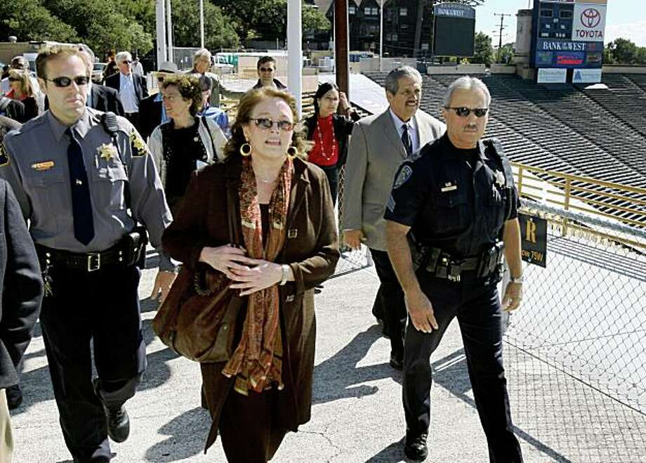 Alameda County Superior Court Judge Barbara Miller toured Memorial Stadium with an entourage of attorneys and police officers in Berkeley, Calif. on Thursday, Oct. 4, 2007. Miller requested the personal tour to gather more information on the lawsuits covering the proposed athletic facility the university is seeking to build.  PAUL CHINN/The Chronicle Photo: Paul Chinn, The Chronicle