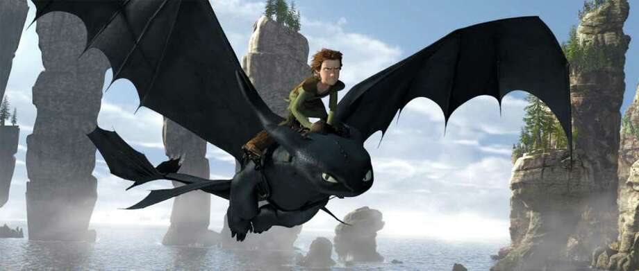 "Hiccup, voiced by Jay Baruchel, rides Toothless a scene from ""How to Train Your Dragon."" Photo: Anonymous / Paramount Pictures"