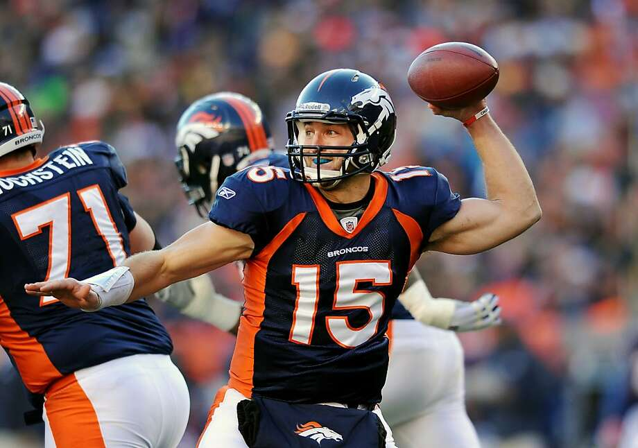 Denver Broncos quarterback Tim Tebow throws in an NFL wild card playoff football game against the Pittsburgh Steelers on Sunday, Jan. 8, 2012, in Denver. The Broncos won 29-23 in overtime. (AP Photo/Chris Schneider) Photo: Chris Schneider, Associated Press