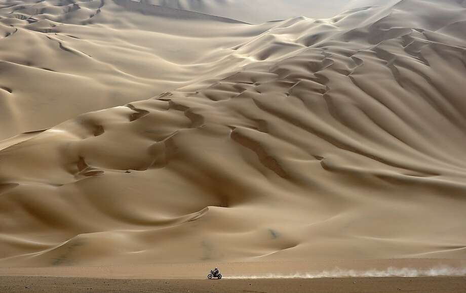 Where did everyone go? A lone motorcyclist rides across the desert during stage 11 of the Dakar 2012 between Arica and Arequipa, Chile. Photo: Philippe Desmazes, AFP/Getty Images
