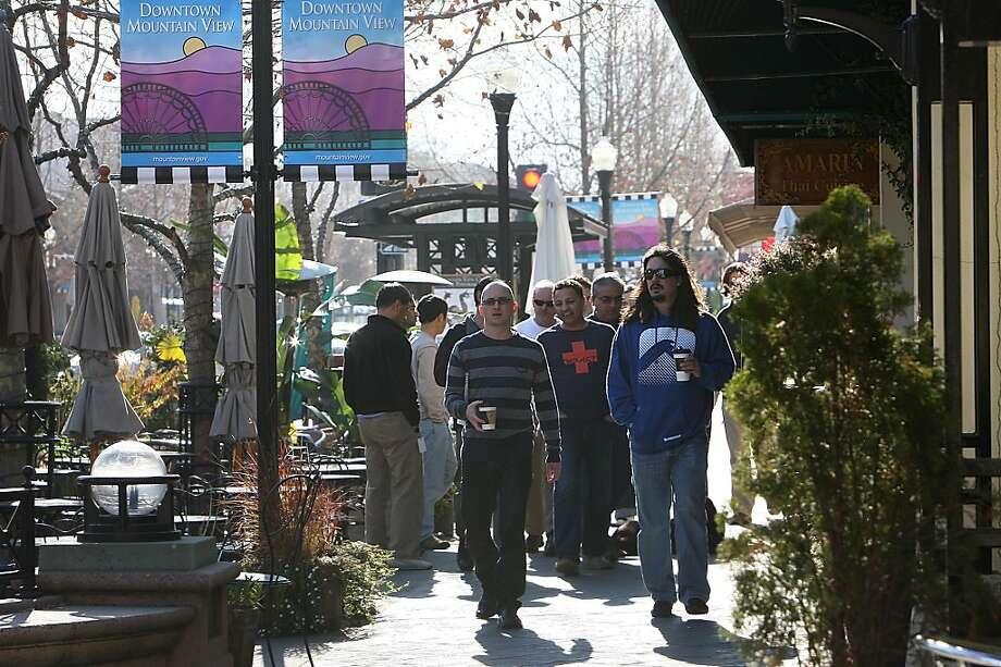 Software consultant Chris Degiere (middle left) and information management consultant Deno Vichas (right) going back to work from having lunch on Castro St. in MountainView, Calif., on Wednesday, January 11, 2012. Photo: Liz Hafalia, The Chronicle