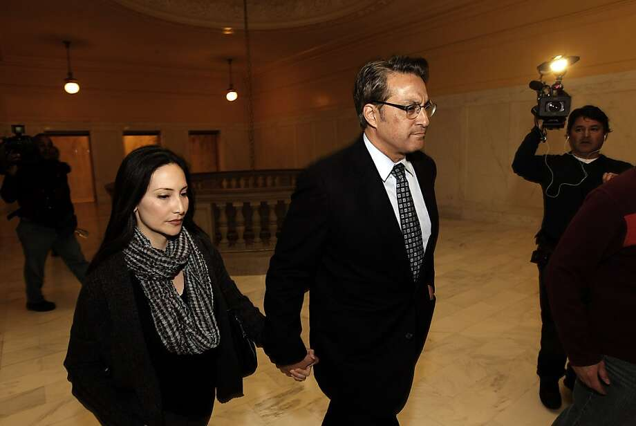 San Francisco Sheriff Ross Mirkarimi with his wife Eliana Lopez, by his side, leaves city hall after speaking to the news media about the three misdemeanor charges against him, on Friday Jan. 13, 2012,  in San Francisco, Ca. Photo: Michael Macor, The Chronicle