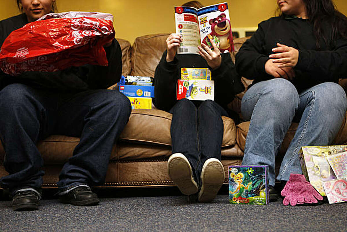 Teenagers at the Sonoma County juvenile detention facility in Santa Rosa , Calif., assemble as they wait to wrap their gifts for Toys for Tots on Thursday, December 16, 2010. They are part of a special Girl Scout Troop which have the girls participate in the annual toys for tots program.