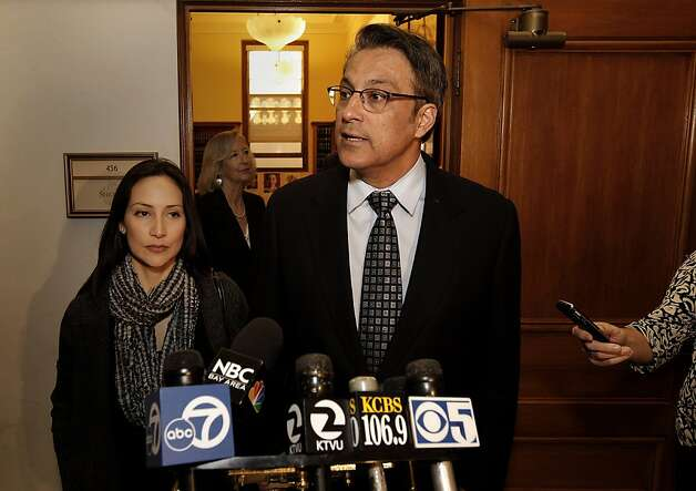 San Francisco Sheriff Ross Mirkarimi with his wife Eliana Lopez by his side, speaks to the news media about the three misdemeanor charges against him, on Friday Jan. 13, 2012, in San Francisco, Ca. Photo: Michael Macor, The Chronicle