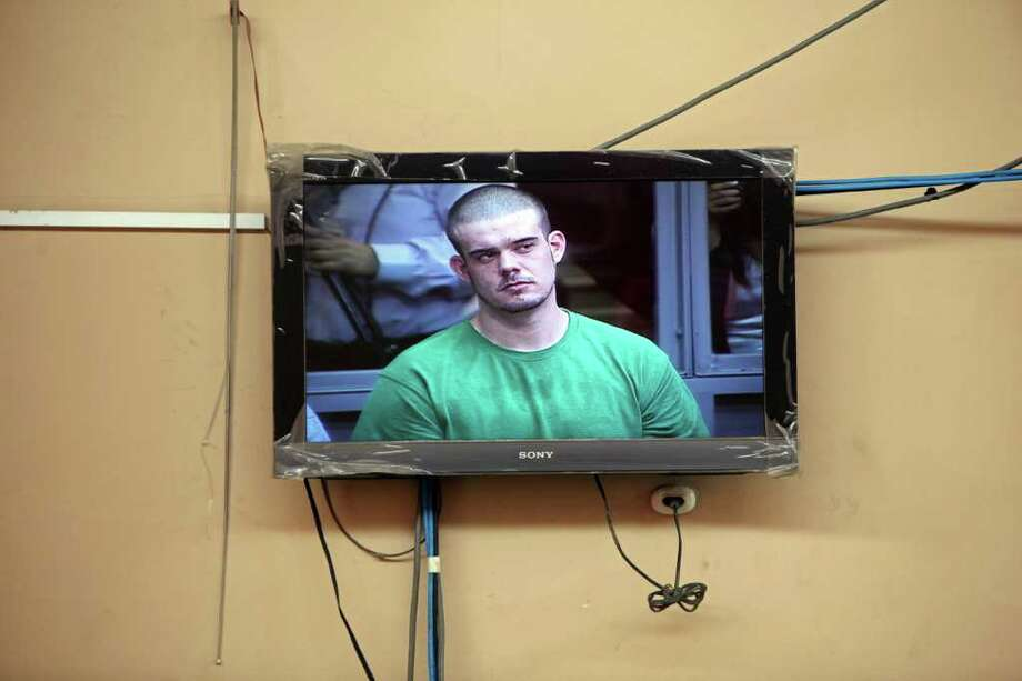 A live image of Joran van der Sloot is seen on a monitor outside the court in the press room during the reading of his sentence at San Pedro prison in Lima, Peru, Friday Jan. 13, 2012.  The Peruvian court sentenced Joran van der Sloot to 28 years in prison for murder of a young woman he met at a Lima casino, as the family of U.S. teenager Natalee Holloway sought to have him prosecuted in the U.S. over her disappearance in 2005. (AP Photo/Karel Navarro) Photo: Karel Navarro / AP