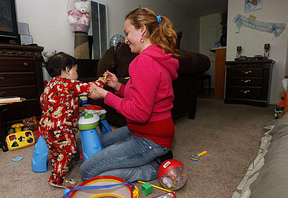 Nayeli Monrroy plays with her ten-month-old son Nathan Vasquez at their new apartment in Sunnyvale, Calif., on Tuesday, Nov. 30, 2010. Photo: Paul Chinn, The Chronicle