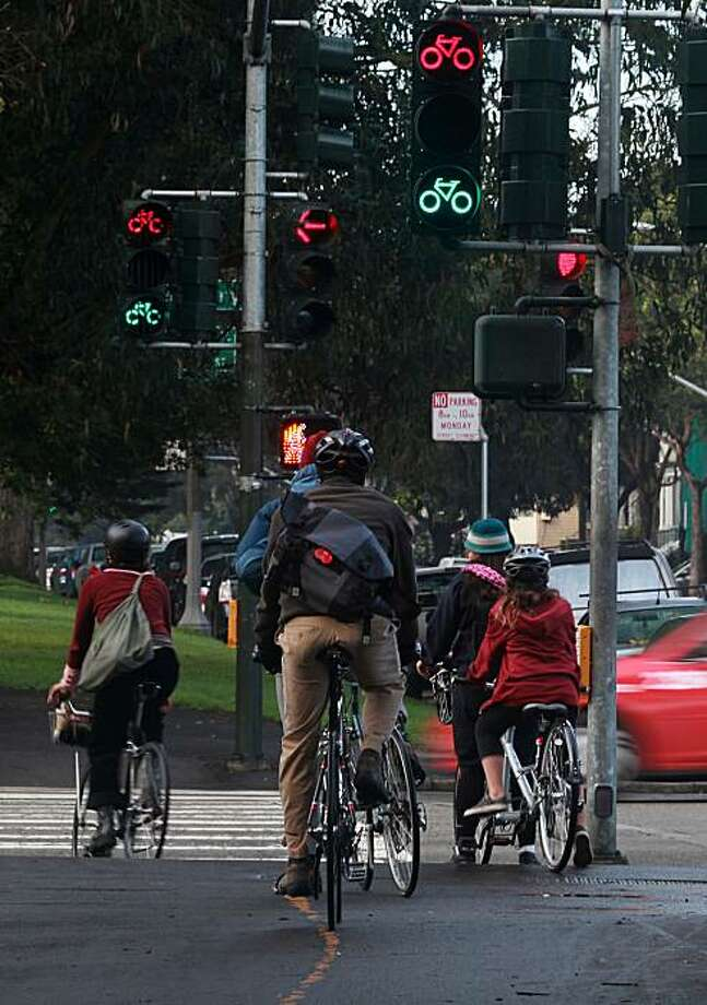 Cyclists wait for the traffic light between signals on Fell at Masonic streets in San Francisco, Calif., on Wednesday, December 15, 2010. Photo: Liz Hafalia, The Chronicle