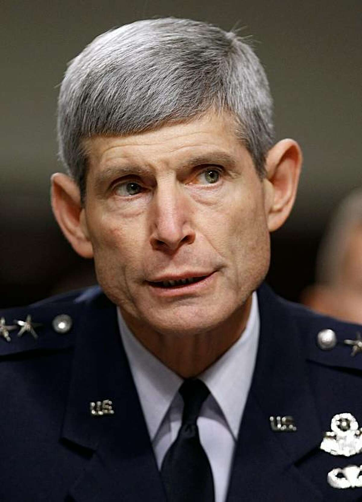 """WASHINGTON, DC - DECEMBER 03: Air Force Chief of Staff Gen. Norton Schwartz testifies before the Senate Armed Services Committee about the military's """"don't ask, don't tell"""" policy on Capitol Hill December 3, 2010 in Washington, DC. U.S. Defense Secretary Robert Gates announced earlier this week that a comprehensive study found that allowing gay men and women to serve openly in the United States armed forces presents a low risk to the military's effectiveness, even at a time of war, and that 70 percent of service members believe that the impact of repealing the law would be either positive, mixed or of no consequence at all."""
