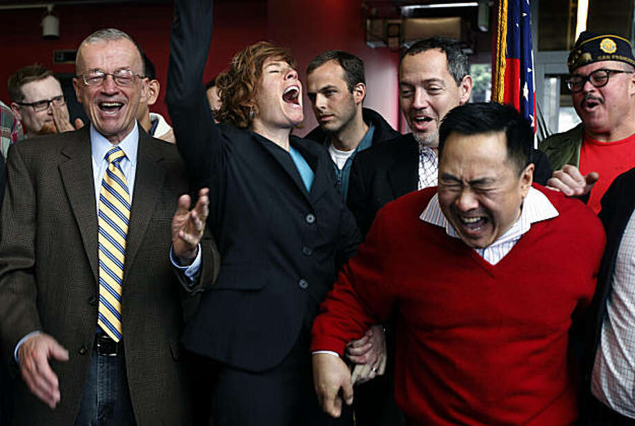 "Retired Navy Cmdr. Zoe Dunning (second from left) celebrates the U.S. Senate's vote to repeal the long-standing ""don't ask, don't tell"" policy in the military Saturday. Photo: Paul Chinn, The Chronicle"