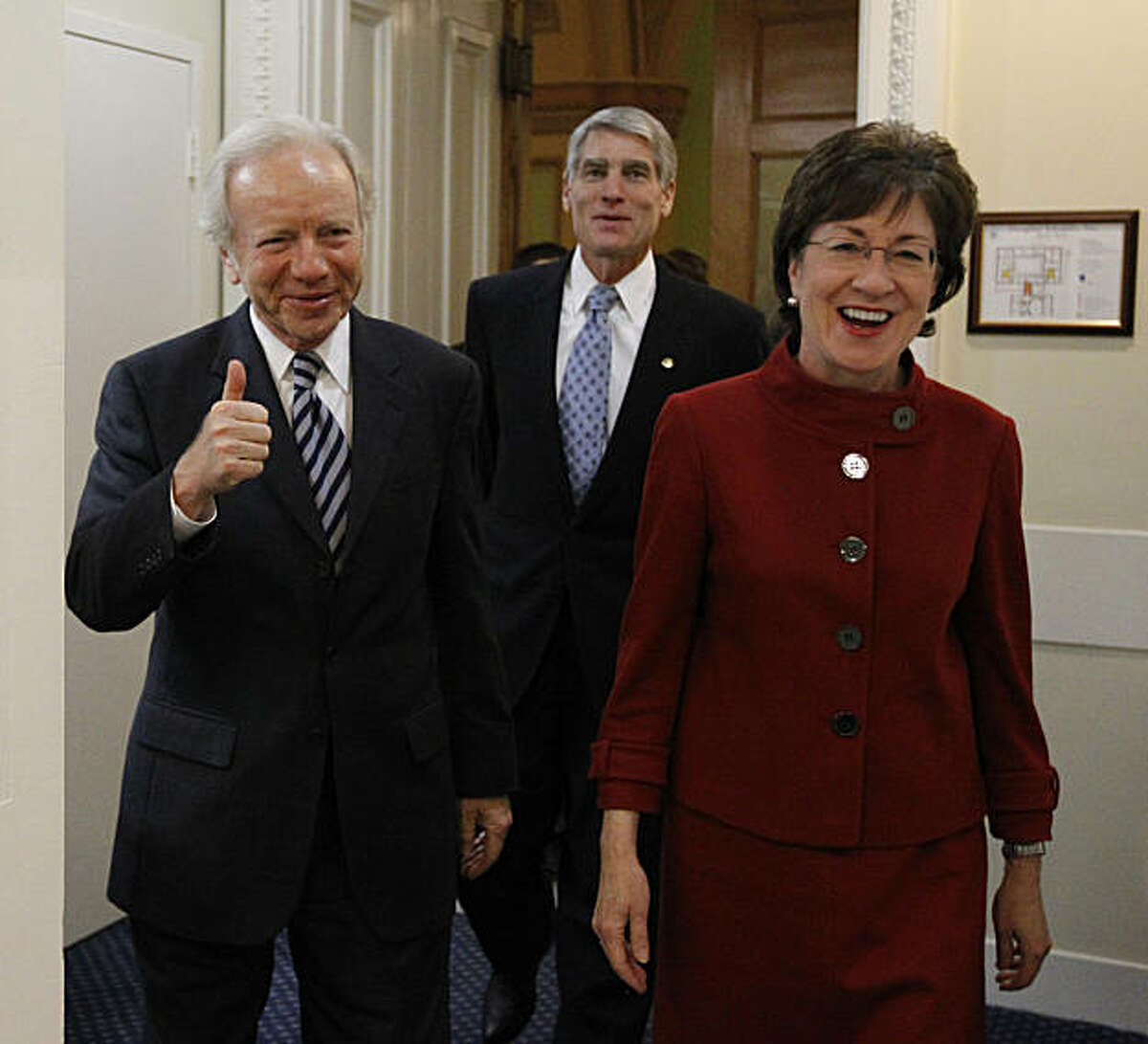 Sen. Joseph Lieberman, I-Conn., left, gives thumbs up, with Sen. Susan Collins, R-Maine., right, and Sen. Mark Udall, D-Colo., as they head into a news conference about the passage of the Don't Ask Don't Tell bill during an unusual Saturday session on Capitol Hill in Washington Saturday, Dec. 18, 2010. In a landmark for gay rights the Senate voted to let gays serve openly in the military, giving President Barack Obama the chance to fulfill a campaign promise and repeal the 17-year policy.
