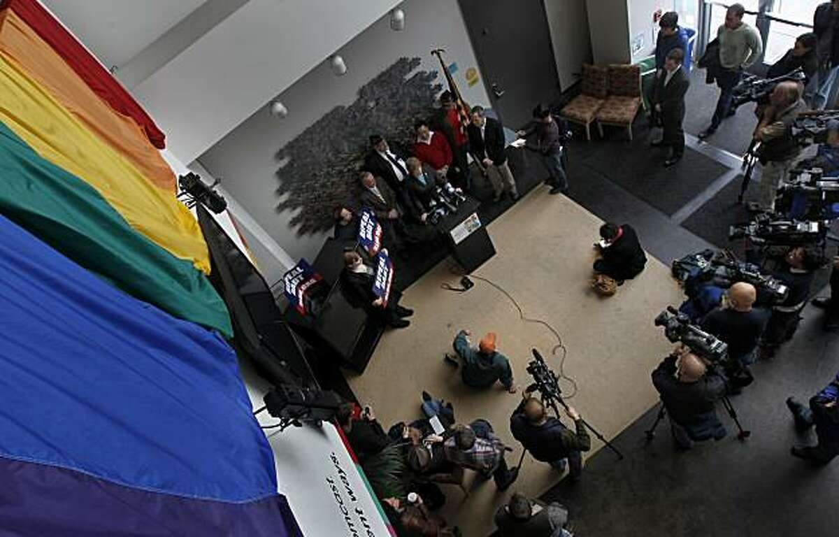 Retired Navy Cmdr. Zoe Dunning stands with fellow gay rights activists in San Francisco after the U.S. Senate voted to repeal the long-standing