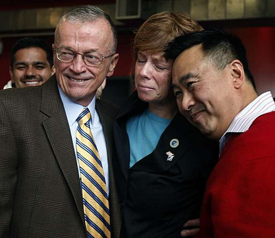 """Retired Navy Cmdr. Zoe Dunning (center) celebrates the U.S. Senate's vote to repeal the long-standing """"don't ask, don't tell"""" policy in the military, with Bob Dockendorff (left), and Julian Chang at the LGBT Center in San Francisco on Saturday. Photo: Paul Chinn, The Chronicle"""