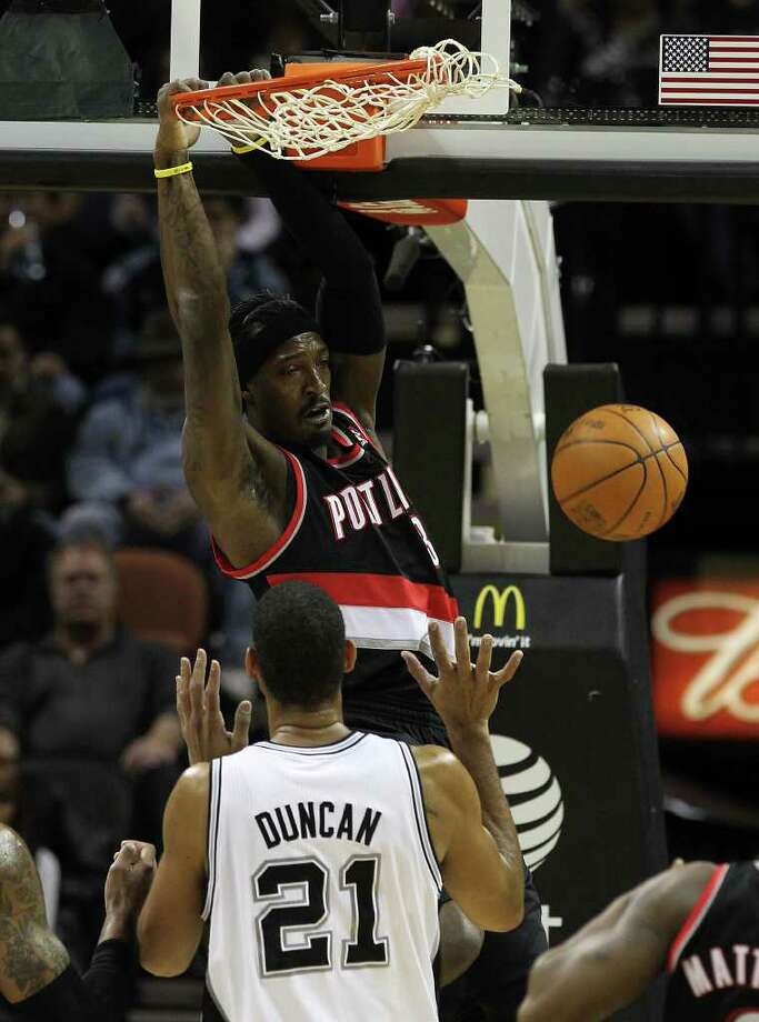 Portland Trailblazers' Gerald Wallace (03) dunks over Spurs' Tim Duncan in the first half at the AT&T Center on Friday, Jan. 13, 2012. Photo: KIN MAN HUI, ~ / San Antonio Express-News