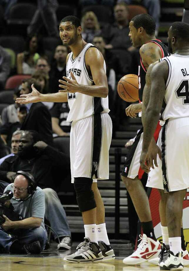 Spurs' Tim Duncan (left) questions a foul during their game against the Portland Trailblazers in the first half at the AT&T Center on Friday, Jan. 13, 2012. Photo: KIN MAN HUI, ~ / San Antonio Express-News