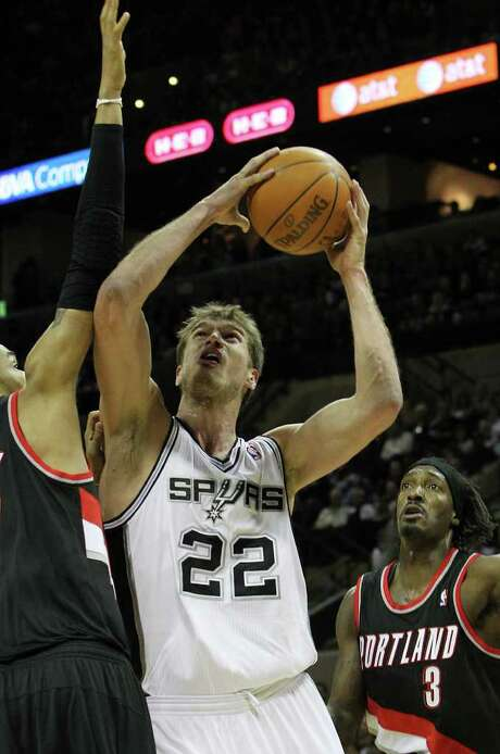 Spurs' Tiago Splitter (22) goes up for a shot against Portland Trailblazers' Chris Johnson (17) in the second half at the AT&T Center on Friday, Jan. 13, 2012. Splitter added 14 points off the bench. Spurs defeated the Trailblazers, 99-83. Photo: KIN MAN HUI, ~ / San Antonio Express-News