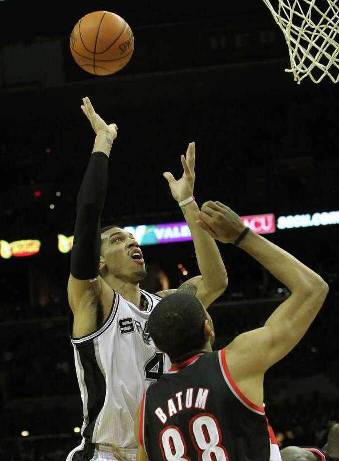 Spurs' Danny Green (04) shoots over Portland Trailblazers' Nicolas Batum (88) in the second half at the AT&T Center on Friday, Jan. 13, 2012. Spurs defeated the Trailblazers, 99-83. Photo: KIN MAN HUI, ~ / San Antonio Express-News