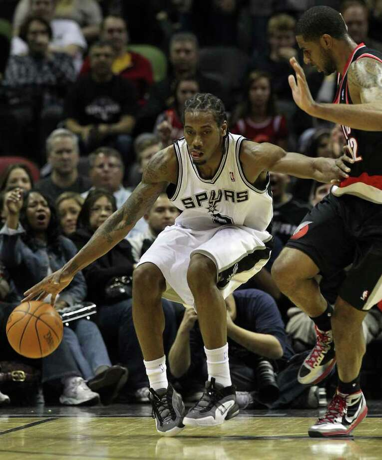 Spurs' Kawhi Leonard (02) clears out Portland Trailblazers' LeMarcus Aldridge after stealing the ball from Aldridge in the second half at the AT&T Center on Friday, Jan. 13, 2012. Spurs defeated the Trailblazers, 99-83. Photo: KIN MAN HUI, ~ / San Antonio Express-News