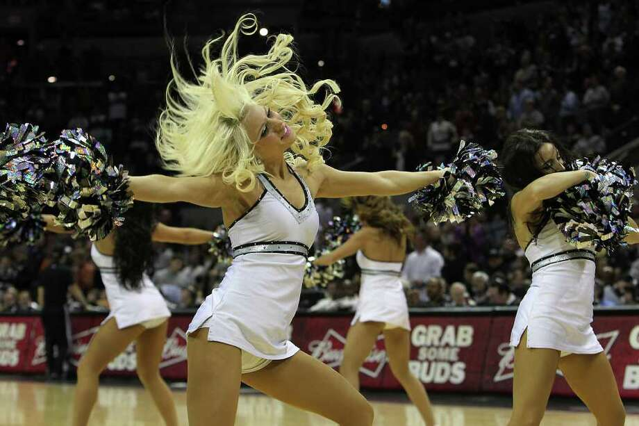 Spurs Silverdancers perform during a timeout in a game against the Portland Trailblazers in the second half at the AT&T Center on Friday, Jan. 13, 2012. Spurs defeated the Trailblazers, 99-83. Photo: KIN MAN HUI, ~ / San Antonio Express-News