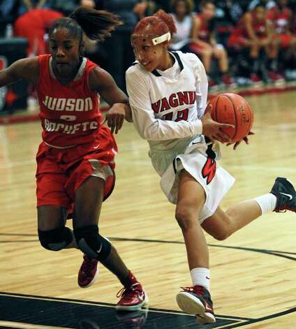 Wagner's Aundrea Davis flies to the hoop against LaQeisha Brown as Wagner plays Judson in girls basketball at Wagner gym on  January 13, 2012 Tom Reel/Staff Photo: TOM REEL, Express-News / © 2012 San Antonio Express-News  MAGS OUT; TV OUT; NO SALES; SAN ANTONIO OUT; AP MEMBERS ONLY; MANDATORY CREDIT; EFE OUT