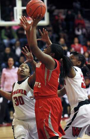 Judson's Breanna Thomas puts up a shot while Tesha Smith and Kaelynn Wilson close in as Wagner plays Judson in girls basketball at Wagner gym on  January 13, 2012 Tom Reel/Staff Photo: TOM REEL, Express-News / © 2012 San Antonio Express-News  MAGS OUT; TV OUT; NO SALES; SAN ANTONIO OUT; AP MEMBERS ONLY; MANDATORY CREDIT; EFE OUT