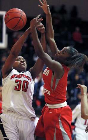 Wagner's Tesha Smith (30) and Breanna Thomas fight for a rebound as Wagner plays Judson in girls basketball at Wagner gym on  January 13, 2012 Tom Reel/Staff Photo: TOM REEL, Express-News / © 2012 San Antonio Express-News  MAGS OUT; TV OUT; NO SALES; SAN ANTONIO OUT; AP MEMBERS ONLY; MANDATORY CREDIT; EFE OUT