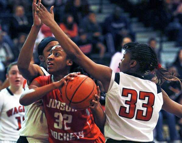 Judson's Simone Fields slips under Kaelynn Wilson as Wagner plays Judson in girls basketball at Wagner gym on  January 13, 2012 Tom Reel/Staff Photo: TOM REEL, Express-News / © 2012 San Antonio Express-News  MAGS OUT; TV OUT; NO SALES; SAN ANTONIO OUT; AP MEMBERS ONLY; MANDATORY CREDIT; EFE OUT