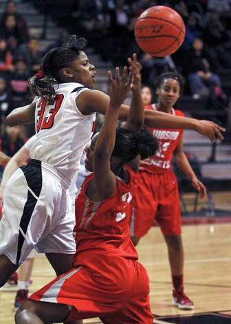 Wagner's Kaelynn Wilson rejects a shot by Breshae Monroe as Wagner plays Judson in girls basketball at Wagner gym on  January 13, 2012 Tom Reel/Staff Photo: TOM REEL, Express-News / © 2012 San Antonio Express-News  MAGS OUT; TV OUT; NO SALES; SAN ANTONIO OUT; AP MEMBERS ONLY; MANDATORY CREDIT; EFE OUT