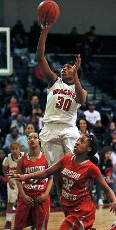 Wagner's Tesha Smith pulls up for a high jmper against Simone Fields as Wagner plays Judson in girls basketball at Wagner gym on  January 13, 2012 Tom Reel/Staff Photo: TOM REEL, Express-News / © 2012 San Antonio Express-News  MAGS OUT; TV OUT; NO SALES; SAN ANTONIO OUT; AP MEMBERS ONLY; MANDATORY CREDIT; EFE OUT