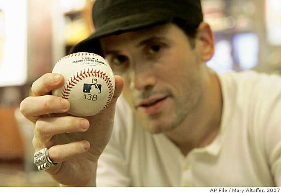 Fashion designer Marc Ecko poses with Barry Bonds' record-breaking home run baseball Monday, Sept. 17, 2007, in New York. Ecko was the winning bidder in the online auction for the ball from Bonds' 756th career home run, and has announced that it is now in the public's hands. Ecko announced Monday he was taking votes on whether to give the ball to the Hall of Fame, brand it with an asterisk or blast it into space. (AP Photo/Mary Altaffer) Photo: Mary Altaffer, 2007, AP File