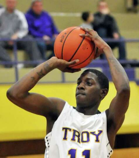 Troy High guard Trahmier Burrell takes a shot during Friday's game against Bishop Gibbons at Troy Hi