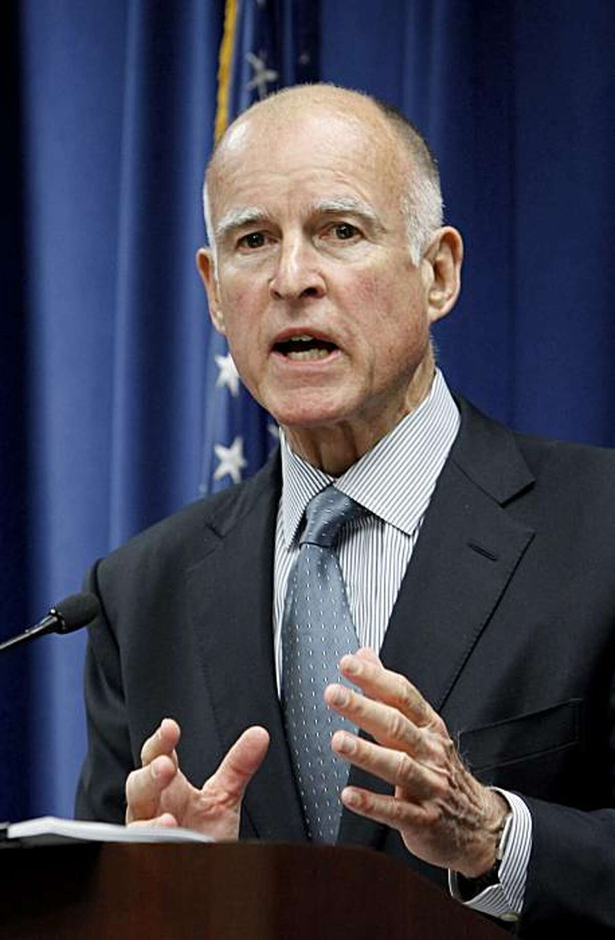 Attorney General Jerry Brown gestures as he discusses a lawsuit his office filed against two former officials of CalPERS, the nation's largest public pension fund, for fraud during a news conference in Sacramento, Calif., Thursday, May 6, 2010. The lawsuit, which was filed Wednesday in Los Angeles County Superior Court. alleges that former CalPERS Chief Executive Federico Buenrostro Jr. and former CalPers board member Alfred Villalobos were involved in a system of kickbacks in exchange for outside firmswinning a piece of the fund's lucrative investment portfolio.