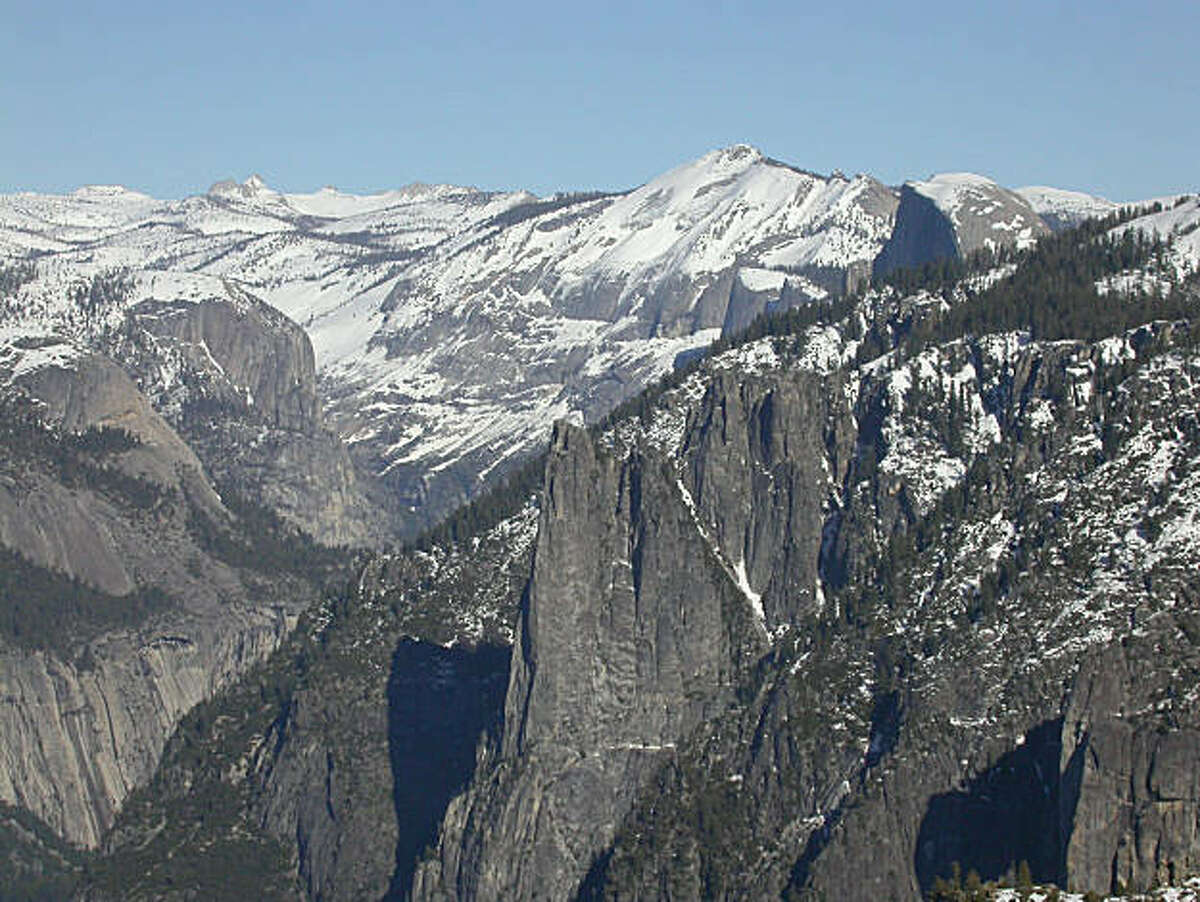 From the south rim atop Yosemite Valley, looking east provides a panorama across Cathedral Rocks, Half Dome and Clark Range. Chronicle Photo: Tom Stienstra