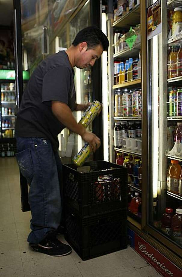"A full shelf of cold Four ƒLoko, the 23.5-ounce cans that contain the candy-flavored malt liquor, were on sale at White Palaceƒ Liquors on Silver Avenue until a Chronicle reporter asked a worker if he was aware of the ban. The worker, who declined to give his last name, said he forgot to pull the $2.75 drinks before Monday, and quickly put a piece of tape across the cans with a sign that read, ""Not for sale,"" before telling another employee to remove the drinks. Photo: Liz Hafalia, The Chronicle"