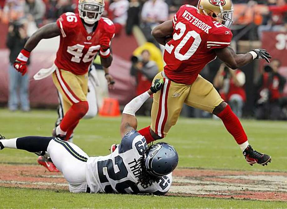 Brian Westbrook breaks a tackle by Earl Thomas as he runs for a 62-yard touchdown in the second quarter against the Seattle Seahawks at Candlestick Park in San Francisco on Sunday. Photo: Carlos Avila Gonzalez, The Chronicle