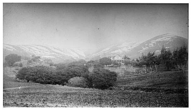 """A photo believed to be the Martin Murry Dunn house at the base of the Berkeley hills. Dunn, an Irish seaman who came to America in 1851, would move to the almost uninhabited area at the bottom of Dead Man's Canyon. Grizzly bear and mountain lion were constantly to be watched for.  1882 was a year when a heavy snowfall struck Berkeley and this is quite possibly a photo documenting the aftermath of that storm. The Dunn house sat at what is now the southeast corner of Domingo Ave. and Tunnel Rd. By 1912, it sat just below and to the south of the new Claremont Hotel, built on part of the old Dunn Ranch property. The canyon is now known as Claremont Canyon.  From the book """"Eccentrics, Heroes, and Cutthroats"""" by Richard Schwartz. Photo: Courtesy Richard Schwartz"""