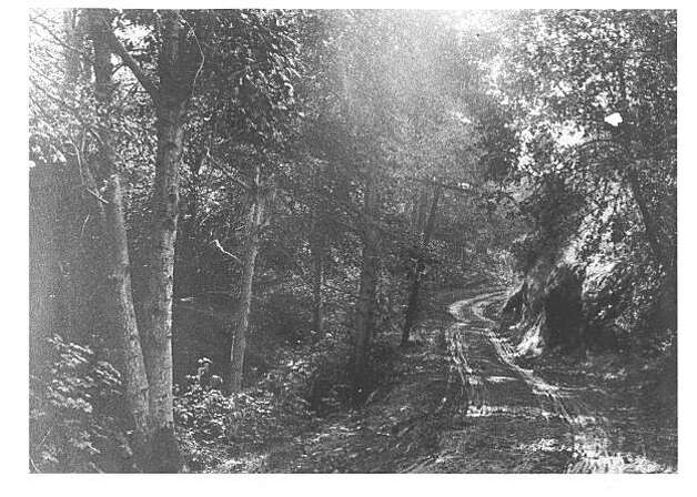 """The old, steep and dangerous road up Claremont Canyon, known variously as The Narrowlands, Deadman's Canyon and later, Thornburg Canyon in its early days in the second half of the nineteenth century. The road sprouted next to the telegraph line, which was strung on poles up the canyon in 1858.  The lines reached from Oakland to Washington, D. C. to connect many western cities to the nation's capital. Settlers could be drawn eastward more easily because of this new road. Pioneers would build ranches by the road in Contra Costa County so as to be able to transport their crops. The road passed right by Martin Murry Dunn's Ranch, which sat at the mouth of the canyon since 1856.  From the book """"Eccentrics, Heroes, and Cutthroats"""" by Richard Schwartz. Photo: Courtesy Richard Schwartz"""